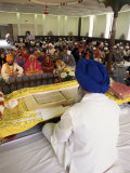 Sikh Priest and Holy Book at Sikh Wedding  London  England  United Kingdom