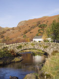 Old Stone Packhorse Bridge Over Watendlath Beck in Picturesque Village in Autumn