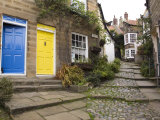 Yellow and Blue Doors on Houses in the Opening  Robin Hood's Bay  England