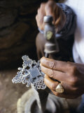 Close-Up of Blacksmith's Hands Working on Metal Cross  Axoum (Axum) (Aksum)  Tigre Region  Ethiopia