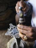 Close-Up of Blacksmith's Hands Working on Metal Cross  Axoum (Axum) (Aksum)  Tigre Region  Ethiopia