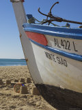 Traditional Fishing Boat and Sand Castles  Fishermans Beach  Albufeira  Algarve  Portugal