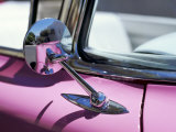 Close-Up of a Wing Mirror and Reflection on a Pink Cadillac Car