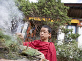 Buddhist Monk Burning Incense  Sey Lhakhang Temple  Bumthang  Bhutan Asia