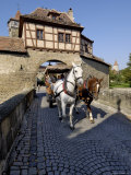 Tourist Horse and Carriage Passing Through the Rodertor  Rothenburg Ob Der Tauber  Germany