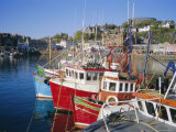 Fishing Boats and Waterfront with Mccaig's Tower on Hill  Argyll  Scotland  UK