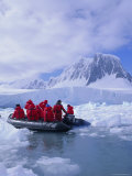 Tourists Ice Cruising in Rigid Inflatable Boat Approaching Crabeater Seal  Antarctica