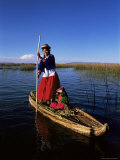 Uros Indian Woman and Traditional Reed Boat  Islas Flotantes  Lake Titicaca  Peru  South America