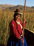 Uros Indian Woman in Traditional Reed Boat  Islas Flotantes  Lake Titicaca  Peru  South America
