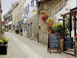 Narrow Street with Half Timbered Houses and Seafood Restaurants  Cote De Granit Rose  Brittany