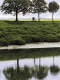 Cyclist on Banks of River Somme  St Valery Sur Somme  Picardy  France