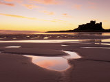 Bamburgh Castle in Silhouette at Sunrise  with Rock Pools on Empty Beach  Northumberland  England