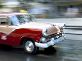 Panned Shot of Old American Car Splashing Through Puddle on Prado  Havana  Cuba  West Indies