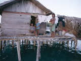 Bajau Family in Stilt House Over the Sea  with Fish Drying on Platform Outside  Sabah  Malaysia