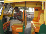 Rickshaw Owner Sitting in His Newly Decorated Moto Rickshaw  Agra  Uttar Pradesh State  India