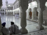 Two Sikhs Priests at Dawn Sitting Under Arcades  Golden Temple  Amritsar  Punjab State  India
