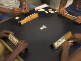 The Hands of a Group of Four People Playing Dominos in the Street Centro Habana