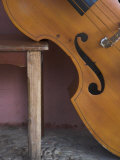 A Counterbass Leaning Against a Wooden Table  Trinidad  Sancti Spiritus Province  West Indies