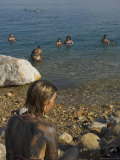Woman's Back Covered with Mud and People Floating in the Sea in Background  Dead Sea  Israel