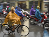 People Riding Bikes and Mopeds in the Rain Wearing Nylon Protection  Old Quarter  Hanoi  Indochina