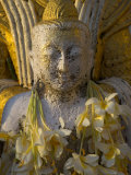 Close up of Small Buddha Figure with Flowers Round the Neck in the Shwedagon Paya  Yangon  Myanmar