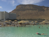 People Floating in the Sea and Hyatt Hotel and Desert Cliffs in Background  Dead Sea  Middle East
