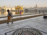 Elderly Sikh Pilgrim with Bundle and Stick Walking Around Holy Pool  Amritsar  India