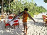 Boy Carrying Freshly Caught Swordfish  Embudu  the Maldives  Indian Ocean