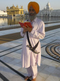 Sikh Pilgrim with Orange Turban  White Dress and Dagger  Reading Prayer Book  Amritsar