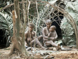 Pygmy Women and Children Outside Huts  Central African Republic  Africa