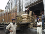 Truck Drivers in Front of Tea Sacks Being Unloaded at Kolkata Port