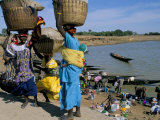 Women with Baskets of Laundry on Their Heads Beside the River  Djenne  Mali  Africa