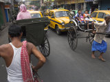 Hand Pulled Rickshaws and Yellow Taxis  Kolkata  West Bengal State  India