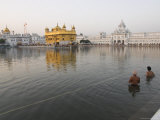 Two Sikh Pilgrims Bathing and Praying in the Early Morning in Holy Pool  Amritsar  India