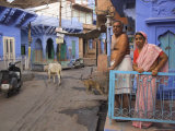Couple Standing Outside Blue Painted Residential Haveli  Old City  Jodhpur  Rajasthan State  India