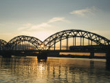Sunset on the Daugava River and Steel Arches of Railway Bridge  Riga  Latvia  Baltic States