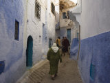 Woman Walking Through Pastel Coloured Streets of Chefchaouen  Morocco  North Africa  Africa