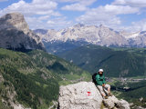 Hiker Resting at Alta Via Dolomiti Trail with Corvara Village Below  Dolomites  Alto Adige  Italy