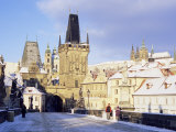 Snow-Covered Gothic Charles Bridge with Baroque Statues  Mala Strana  Czech Republic
