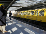 Passengers on the Platform and a Yellow Train  Mendelsshon U-Bahn Station  Berlin  Germany