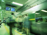 Passengers Boarding Train at Parliament Station in the City of Melbourne  Victoria  Australia