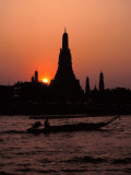 Silhouette of Wat Arun (Temple of the Dawn)  at Sunset  on Banks of Chao Phraya River  Thailand
