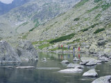 Hikers Walking Along Batizovske Pleso (Lake) in Vysoke Tatry Mountains  Presov Region  Slovakia