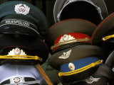 A Pile of Communist Era Army and Police Hats for Sale as Souvenirs  Mitte  Berlin  Germany