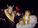 People Dressed up as the Devil and Two Angels in the Old Town on Eve of St Nicholas Day