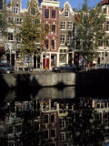 Tall Traditional Style Houses Reflected in the Water of a Canal  Amsterdam  the Netherlands