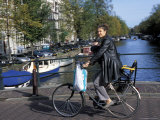 A Dutch Woman with Her Baby Cycling Along Kaizersgracht Canal  Amsterdam  the Netherlands (Holland)