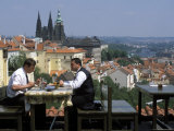 Two Men Having Lunch Outdoors  Enjoying the View of Prague Castle from the Restaurant Ozivle Drevo
