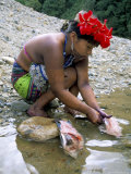 Embera Indian Cleaning Fish  Soberania Forest National Park  Panama  Central America