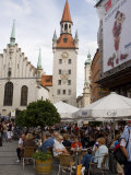 People Sitting at an Outdoors Cafe in Front of the Old City Hall  Munich  Bavaria  Germany